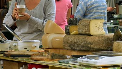 Cheese vendor at market