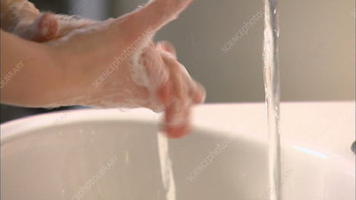 Female nurse washing her hands