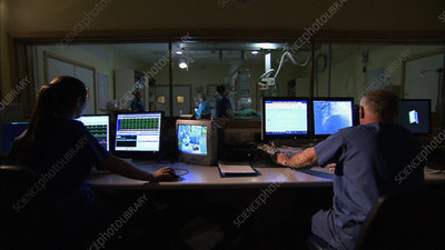 Technicians in theatre control room