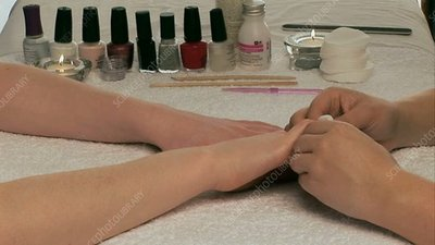 Woman's nails getting painted
