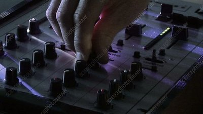 DJ mixing faders at a club