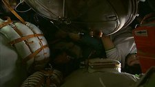 Working in a Soyuz capsule on the ISS