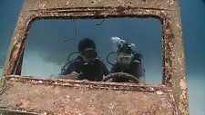 Divers in a sunken jeep