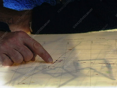 Reading a map on a ship