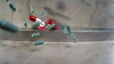 Pills falling onto marble surface
