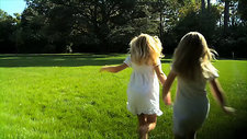 Girls running on the grass