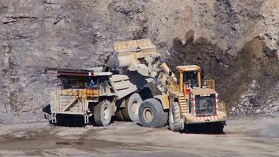 Quarry truck and loader