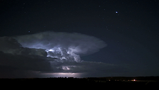 Thunderstorms passing at night