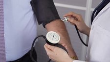 Doctor taking blood pressure