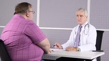 Doctor consulting with obese patient
