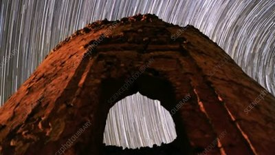 Star trails over ruined tower
