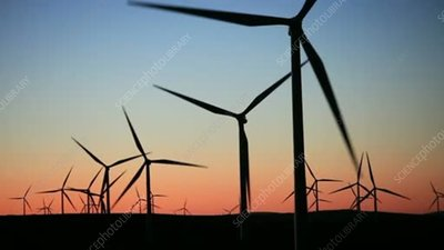 Silhouetted wind turbines