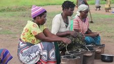 Women cooking in refugee camp, Malawi