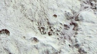 Mountains and ice on Pluto, New Horizons