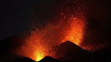 Lava erupting at night from Fogo volcano