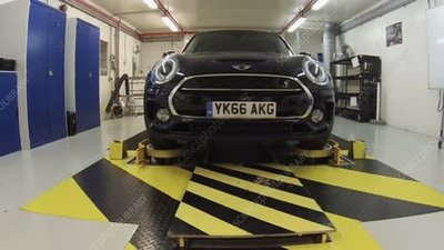 Mini car having its suspension tested