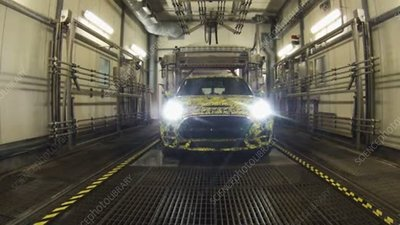 Car being washed after assembly, time-lapse footage