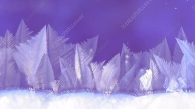 Ice crystals forming on glass