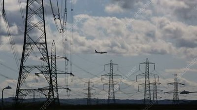 Electricity pylons and plane