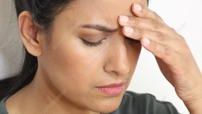 Woman with tension headache