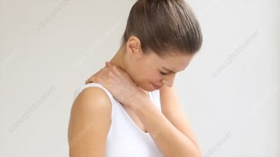 Woman rubbing painful shoulder