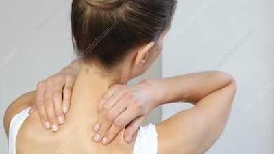 Woman rubbing painful neck