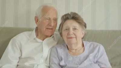 Elderly couple posing for a photo
