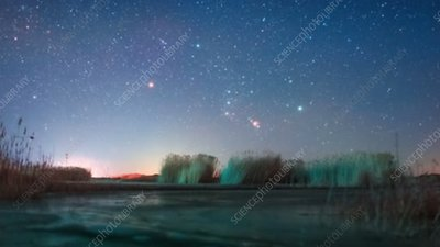 Orion constellation rising over a lake, time-lapse footage