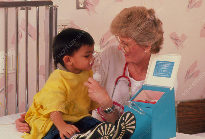 Nurse treating asthmatic infant