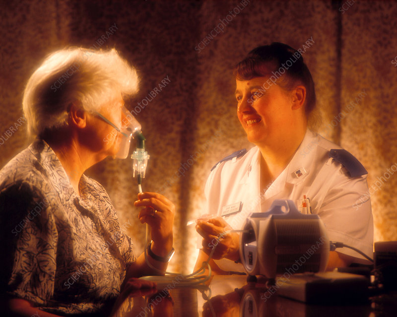 Elderly woman using a nebulizer for asthma