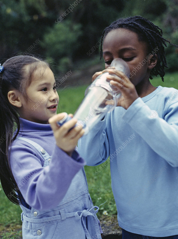 Children using asthma inhaler