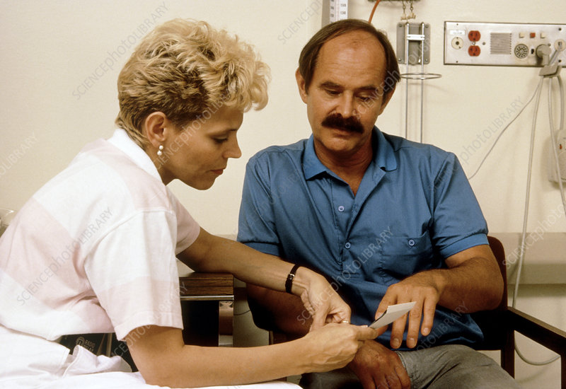 AIDS patient in discussion with social worker