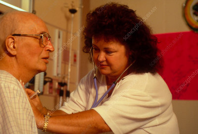 Cancer patient is examined by an oncology nurse