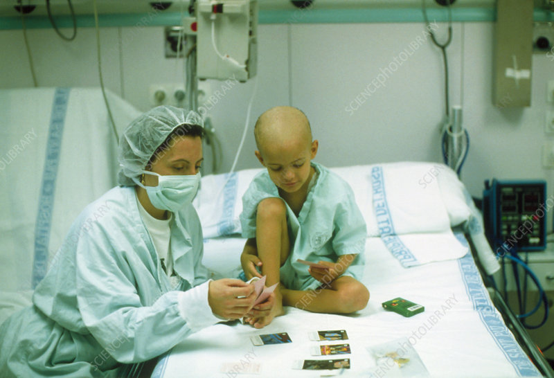 Leukaemia patient & mother play cards in hospital