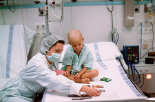 Child with leukaemia plays cards in hospital