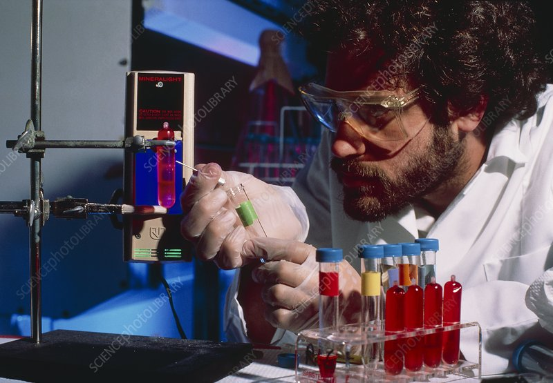 Researcher extracting plasmid DNA from solution