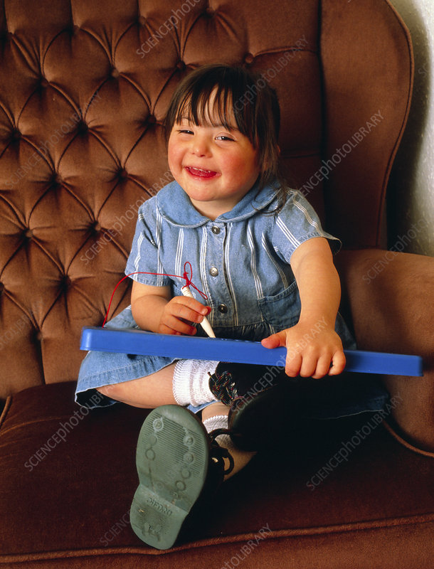 Four year old girl with Down's syndrome playing