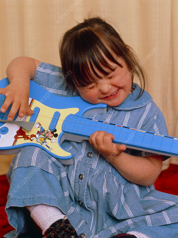 4-year-old girl with Down's syndrome plays guitar