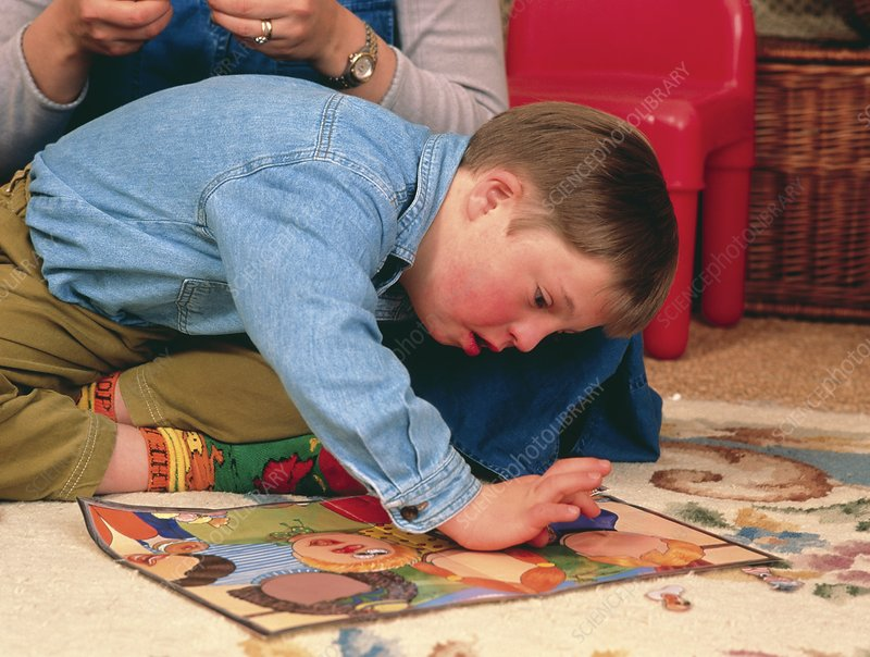 7-year-old boy with Down's syndrome playing a game