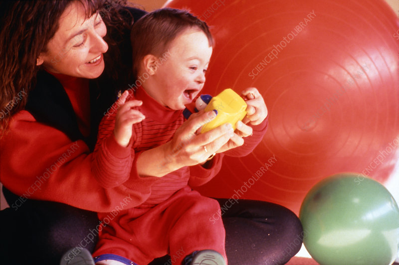 Mother playing with her Down's syndrome child