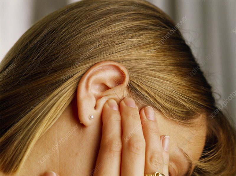 Woman suffering from earache