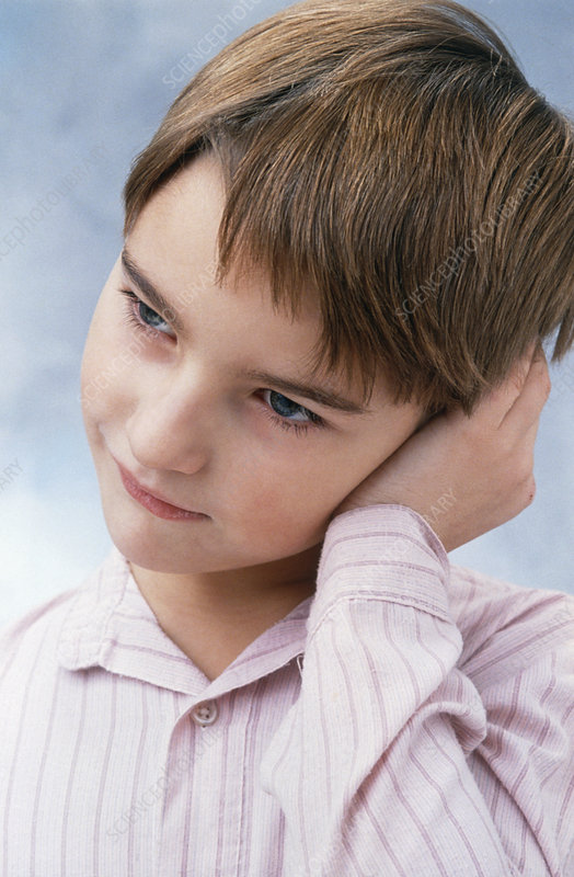 Child holding his ear in pain from otitis media