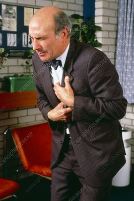 Man with angina clutching his chest