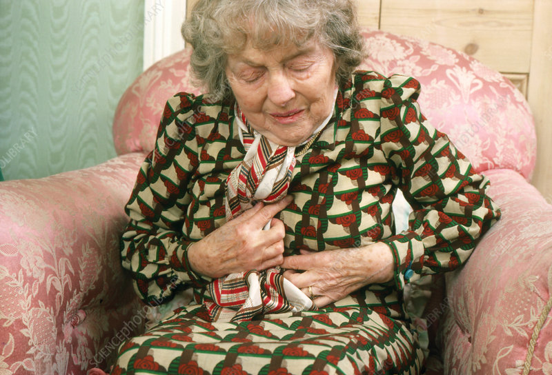 Elderly woman experiencing angina pectoris