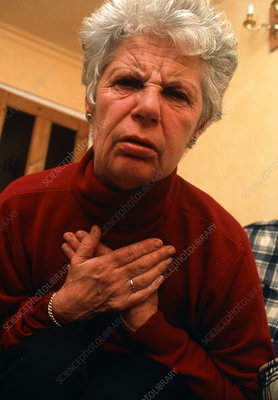 Elderly woman having angina attack