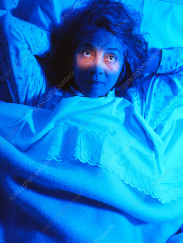 Insomnia: woman in bed unable to sleep