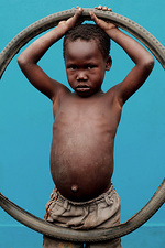 Child with bicycle tyre