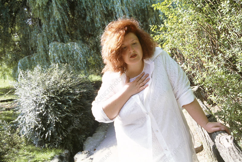 Out of breath obese woman holding her chest