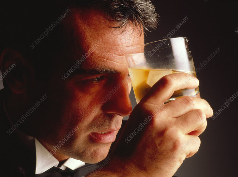 Depressed man holding a drink