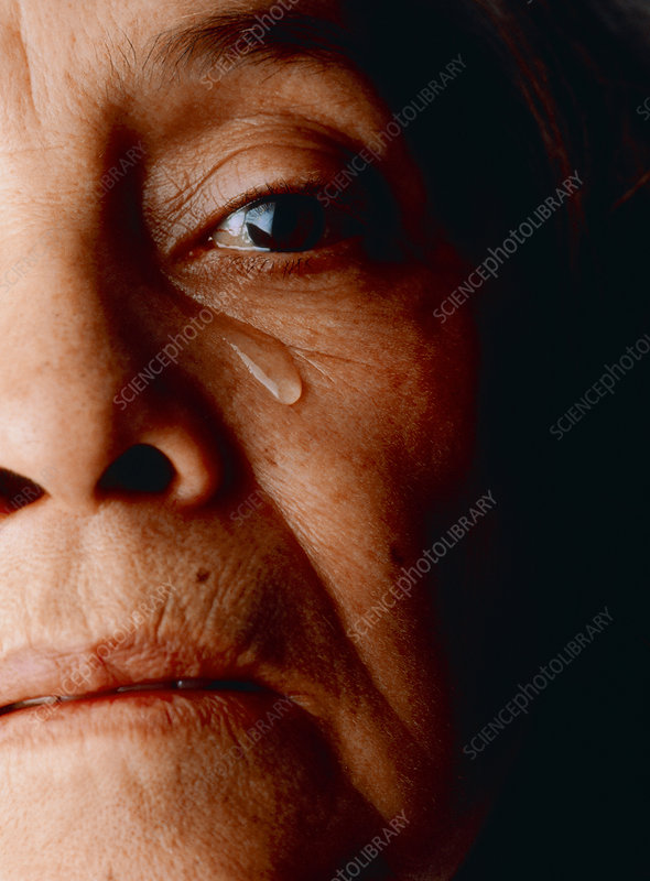 Face of a depressed and tearful elderly woman